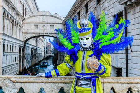 Venice, Italy. Beautiful mask at bridge of Sighs during the carnival of Venice. Sajtókép