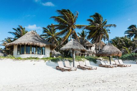 Tulum, Yucatan, Riviera Maya. Beach houses and palms on the shores of the Caribbean Sea in Tulum, Mexico.