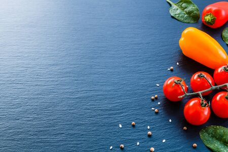 Fresh vegetables and spices from above with negative space for text and graphics. Stock fotó