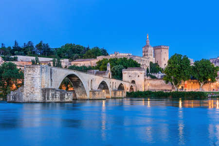 Avignon Bridge with Popes Palace and Rhone river at night, Pont Saint-Benezet, Provence, France.