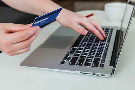Online shopping. Woman holding credit card and using laptop. Stock fotó