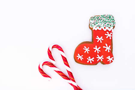 Gingerbread cookie and  candy cane on white background. Stock fotó