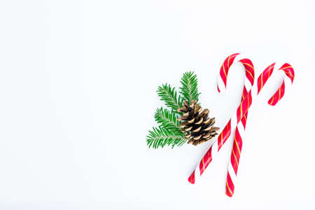 Holiday ornament with candy cane, tree branches and pinecone on white background. branches and pine cone on white background. Stock fotó