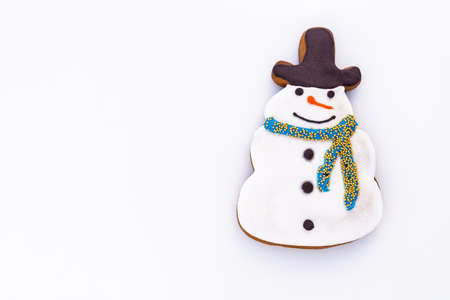 Snowman shaped gingerbread on a white background with empty space for text.