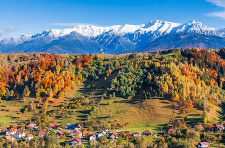 Brasov, Romania. Autumn landscape of Moieciu village and Bucegi mountain range. Stock fotó