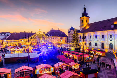 Sibiu, Romania. Christmas Market in Piata Mare at twilight. Transylvania, Romania. Stock fotó
