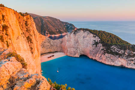 Zakynthos, Greece. Navagio Beach with shipwreck at sunset. Banque d'images