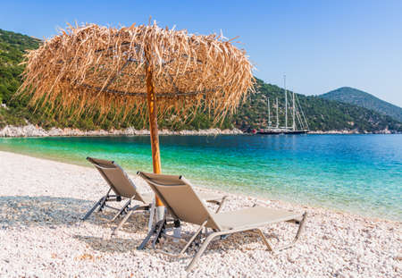 Kefalonia, Greece. Beach chair and umbrella at the Antisamos beach.