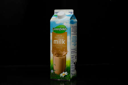 Left view of one liter of a low fat mochaccino milk box from the Greenfields trademark originally from Malang, Indonesia, isolated in a black background.