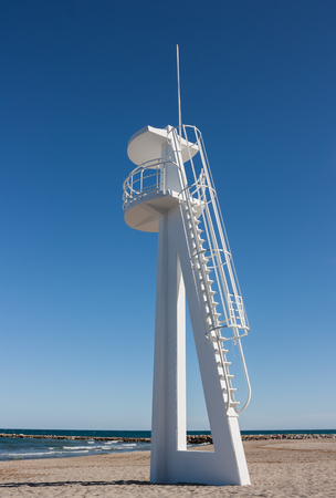 baywatch: Lifeguard or baywatch tower on beach against blue sky   Stock Photo