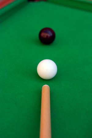 Billiard or pool game. Black eight ball close to the corner pocket.