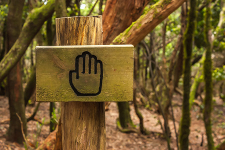 negative area: Stop sign on forest path in Spain Stock Photo