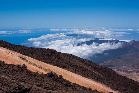 eruptive: Volcanic lava landscape above the clouds. Tenerife, Spain Stock Photo