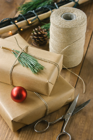 hand crafted: Hand crafted gifts on rustic wooden background with Christmas decoration.