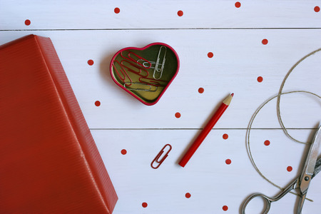 Red gift on white wooden background on Valentines Day photo