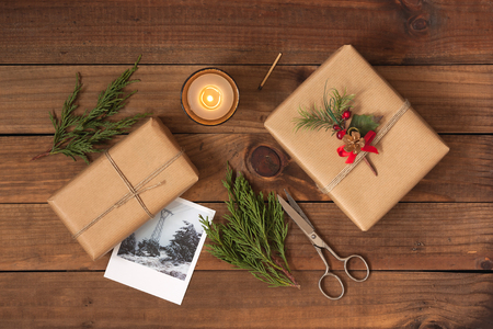 hand crafted: Hand crafted gifts on rustic wooden background with Christmas decoration Stock Photo
