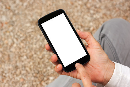 hand touch: Close up view of smart phone with white blank empty screen. Stock Photo
