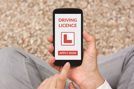 licence: Hands holding smartphone with driving licence app mock up on screen. All screen content is designed by me