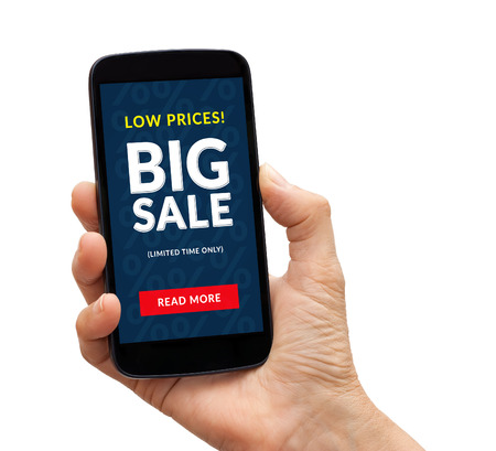 cheapness: Hand holding a black smart phone with big sale concept on screen. Isolated on white background. All screen content is designed by me.