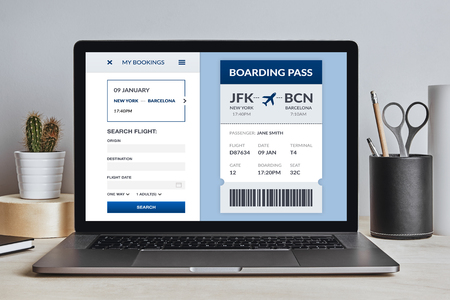 Boarding pass concept on laptop screen on modern desk. All screen content is designed by me. Front view.