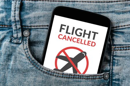 Flight cancelled concept on smartphone screen in jeans pocket. Standard-Bild