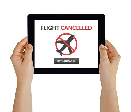 Hands holding digital tablet computer with flight cancelled concept on screen. Isolated on white.