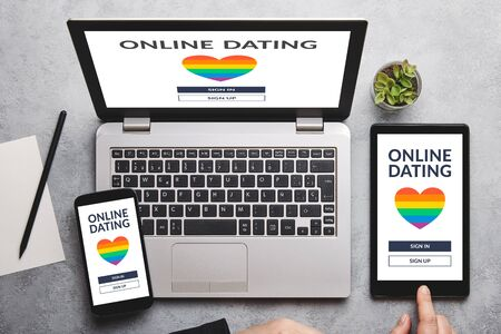 dating app concept on laptop, tablet and smartphone screen over gray table. online dating. Flat lay Standard-Bild