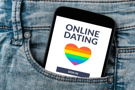 Dating app concept on smartphone screen in jeans pocket. Online dating.