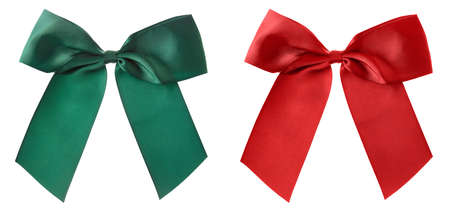 Big green and red bows for gift wrapping isolated on white background. Banque d'images