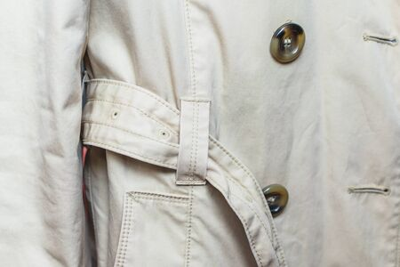 woman trench in beige. Closeup details 스톡 콘텐츠