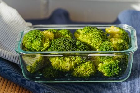 broccoli in a glass reusable container. No plastic concept