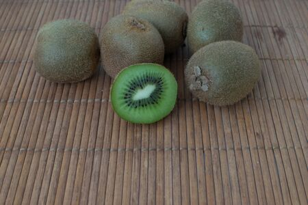 Kiwi fruit on a wooden table with space for copy text