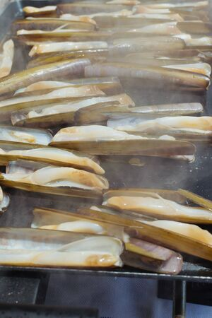 delicious razor shell seafood grilled outdoors