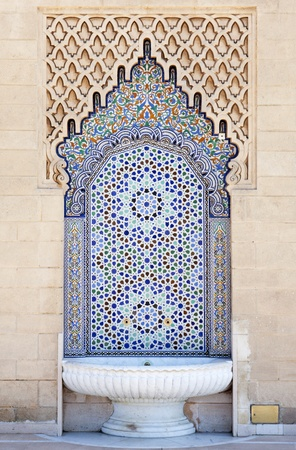 Moroccan fountain with mosaic tiles Stock Photo