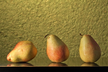 Still-life of three pears in a row