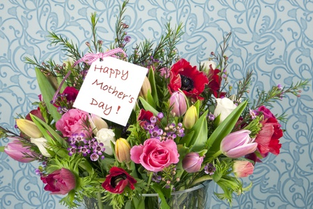 A beautifil bouquet with roses, tulips and anemones for Mothers Day with a card on it Stock Photo