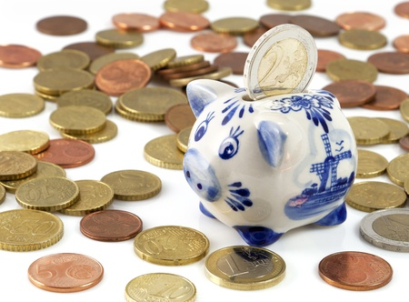 Piggy bank with euros and a typical Dutch pattern
