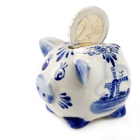 Piggy bank with euro coin and a typical Dutch pattern