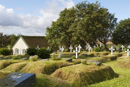 Cemetery at an old traditional church in the little village Hof,  Iceland Stock Photo