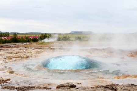 erupt: The Strokkur geyser in Iceland about to erupt Stock Photo