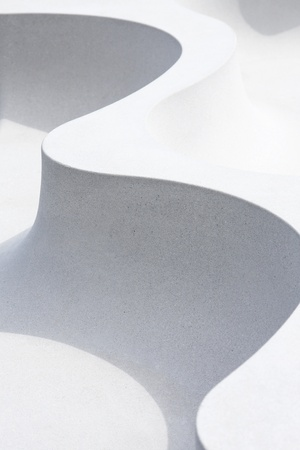 Abstract image of rounded shapes and shadows from a concrete bench