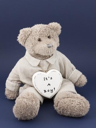 Teddybear and a heart written on it: its a boy Stock Photo