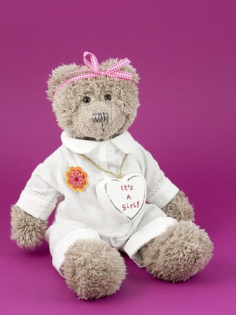 Teddybear and a heart written on it: its a girl Stock Photo