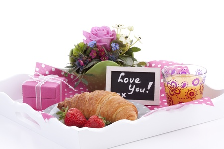 Delicious breakfast, a pink giftbox and a little chalkboard with the words  photo