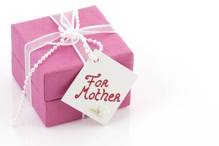 Beautiful pink giftbox with a card on it for mother