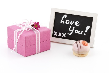 Beautiful pink gift box, a little chalkboard with the words