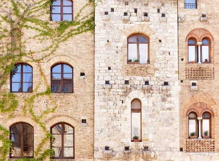 Windows in ancient Tuscan houses in San Gimignano, Italy