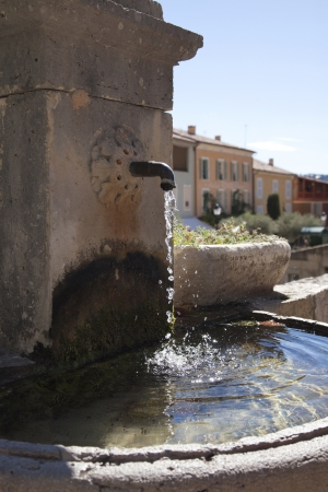 watertap: old french watertap with crystal clear water
