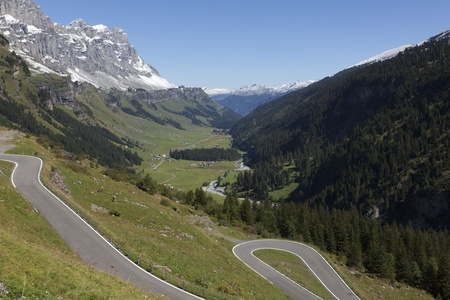 Winding road in the Swiss alps, Klausen Pass, Switzerland photo