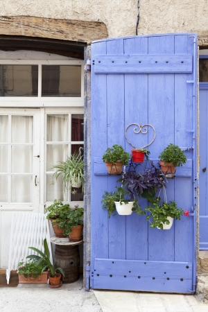 French lavender blue door with plants Stock Photo